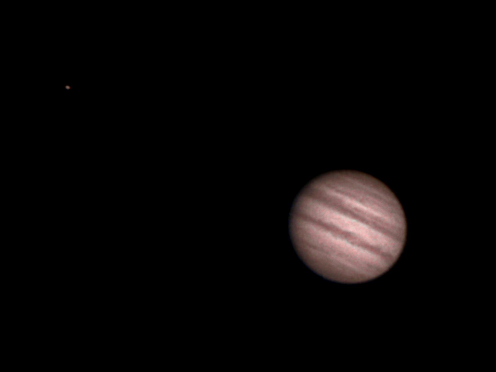 Jupiter a jeho měsíc Io